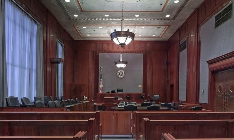 Inside of a courtroom showing the seating area for a jury panel
